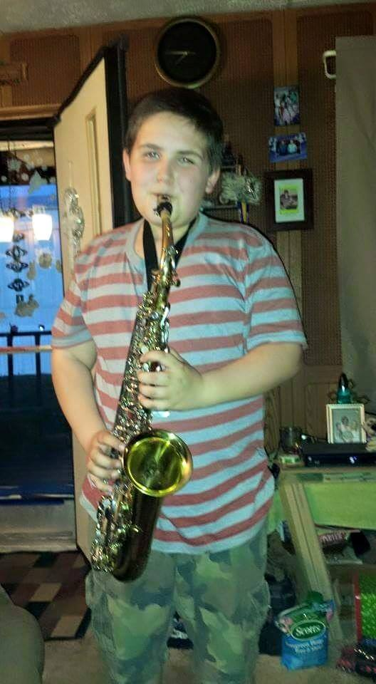 Young man who received a saxaphone from Play It Forward